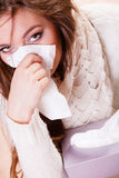 Sick woman girl with fever sneezing in tissue Royalty Free Stock Photography