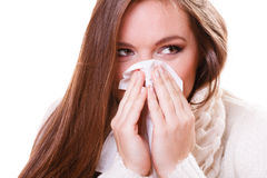 Sick woman girl with fever sneezing in tissue Stock Images