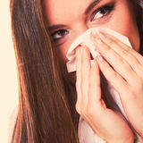 Sick woman girl with fever sneezing in tissue Royalty Free Stock Image
