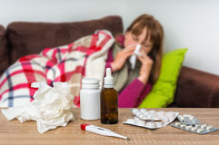 Sick woman having flu and blowing her runny nose Stock Photos