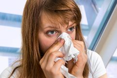 Sick woman having flu and sneezing into handkerchief Royalty Free Stock Photo