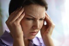Sick woman with headach Stock Photos