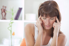 Sick woman with headache Stock Image
