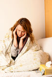 Sick woman with headache in bed Royalty Free Stock Images
