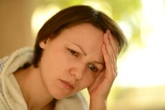 Sick woman. With headache holding her head with hands Royalty Free Stock Images