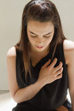 Sick woman with heart problem or chest pain Royalty Free Stock Photography