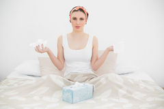 Sick woman holding handkerchiefs Stock Images