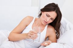 Sick Woman Holding Medicines Royalty Free Stock Photo
