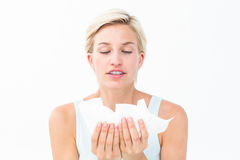 Sick woman holding tissues Stock Photography