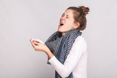 Sick woman holds a handkerchief and sneezes Royalty Free Stock Photos
