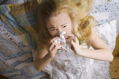 Sick woman lying in bed Royalty Free Stock Images