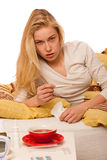 Sick woman lying in bed covered with blanket, feeling ill, has f Stock Images
