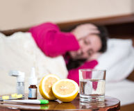 Sick woman lying at bed Stock Images