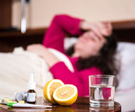 Sick woman lying at bed Royalty Free Stock Image