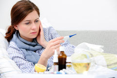 Sick woman  lying in bed Stock Image