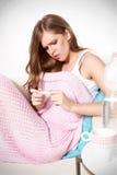 Sick woman measuring her temperature Stock Photo