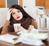 Sick  woman with medications Stock Image
