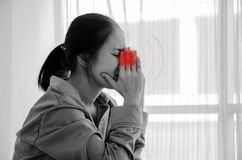 Sick woman with pain. Asian woman are headache severely.Lady wake up in the morning with migraine.Insomnia results in headaches when awakened.Young girl sitting stock photography