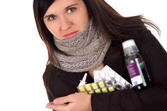 Sick woman. With pills and medicines Royalty Free Stock Photos