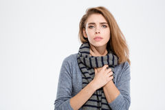 Sick woman with scarf looking at camera. Portrait of a sick woman with scarf looking at camera isolated on a white background Stock Photo