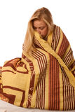 Sick woman sitting on bad wrapped in a blanket feeling ill, has Royalty Free Stock Photography