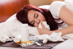 Sick woman sleeping Stock Photography