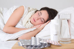 Sick Woman Sleeping In Bed And Pills On The Table Royalty Free Stock Photo