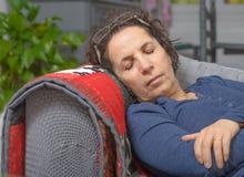 A sick woman sleeping on a sofa Royalty Free Stock Image