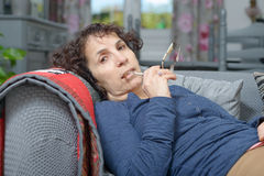 A sick woman sleeping on a sofa Royalty Free Stock Photo