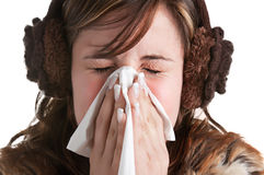 Sick Woman Sneezing. Pale sick woman with a flu, sneezing, in a white background Stock Photo