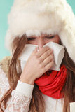 Sick woman sneezing in tissue. Winter cold. Stock Photos