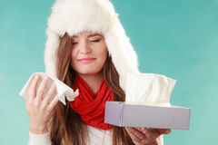 Sick woman sneezing in tissue. Winter cold. Royalty Free Stock Images