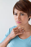 Sick woman with sore throat Royalty Free Stock Image