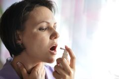 Sick Woman squirting throat Stock Photography