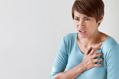 Sick woman with sudden heart attack. Symptom royalty free stock photos