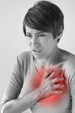 Sick woman with sudden heart attack. Symptom royalty free stock photography