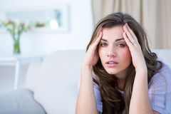 Sick woman suffering from head ache Stock Photos