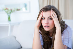 Sick woman suffering from head ache Stock Photography