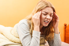 Sick woman suffering from headache pain. Stock Photo