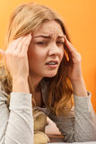 Sick woman suffering from headache pain. Stock Photos