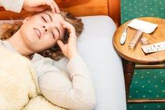 Sick woman suffering from headache pain. Stock Image