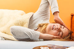 Sick woman suffering from headache pain. Royalty Free Stock Image