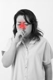Sick woman suffering from runny nose Stock Image