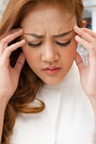 Sick woman suffers from headache, migraine, hangover, stress Stock Photos