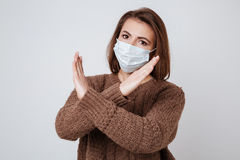 Sick Woman in sweater and medical mask Royalty Free Stock Photography