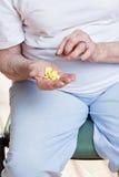 Sick Woman taking her Pills Royalty Free Stock Image