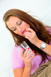 Sick woman taking pill and holding glass of water Stock Image