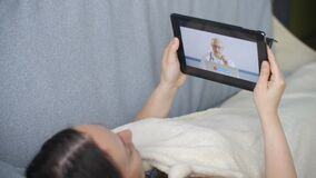 Sick woman talking with doctor by video call on tablet pc screen. Doctor consulting female patient by video conference