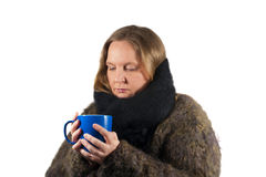 Sick woman with tea cup and scarf Royalty Free Stock Photography