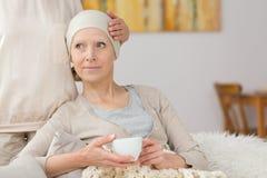 Sick woman and tea Royalty Free Stock Photos